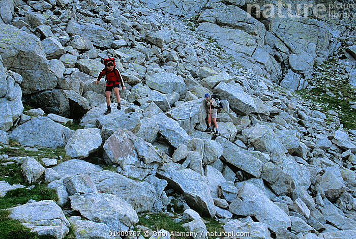 Hikers crossing a scree field in the Collada de Saburo Pass along the  'Carros de Foc' route,  Aiguestortes i Estany de Sant Maurici National Park, Pyrenees, Catalonia, Spain. Model released, EUROPE,HIKING,MOUNTAINEERING,MOUNTAINS,NP,PEOPLE,RESERVE,SPAIN,TREKKING,WALKING,SPORTS,National Park, Oriol Alamany
