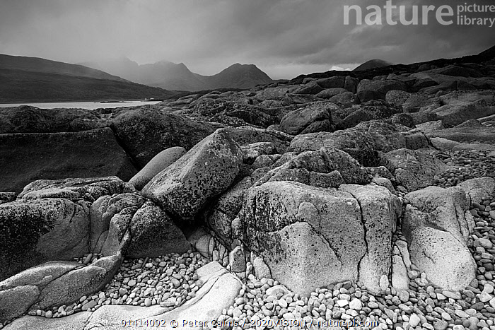 Landscape view of Camus Malag beach on Loch Slapin, looking towards the Cuillin Hills, Isle of Skye, Inner Hebrides, Scotland, UK, October 2012.  ,  2020VISION,ATMOSPHERIC,BEACHES,BLACK AND WHITE,CLOUDS,COASTS,EUROPE,LANDSCAPES,MONOCHROME,MOUNTAINS,ROCKS,SCOTLAND,UK,Weather,United Kingdom,2020cc  ,  Peter Cairns / 2020VISION