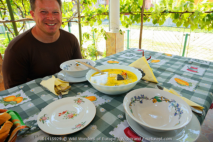 Fish soup serving at Mama Sika's guesthouse, Sfintu Gheorghe, Danube delta rewilding area, Romania, June 2012  ,  DANUBE,DELTA,EASTERN EUROPE,EUROPE,FEEDING,FOOD,HOSPITALITY,HOTELS,MALES,MAN,PEOPLE,REWILDING,STAFFAN WIDSTRAND,TABLES,TOURISM,TRADITIONAL,WETLANDS,WWE  ,  Wild Wonders of Europe / Widstrand