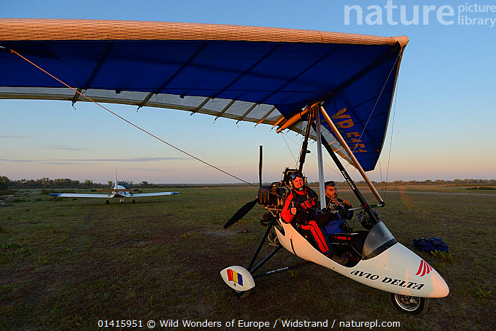 Staffan Widstrand, photographer, and pilot Albert in the Ultralight trike/Deltawing, about to fly over Danube Delta, Danube delta rewilding area, Romania June 2012  ,  ADVENTURE,DANUBE,DELTA,EASTERN EUROPE,EUROPE,HOLIDAYS,MALES,PEOPLE,PHOTOGRAPHERS,PHOTOGRAPHY,REWILDING,STAFFAN WIDSTRAND,TOURISM,TRANSPORT,TRAVEL,WETLANDS,WWE,Concepts  ,  Wild Wonders of Europe / Widstrand
