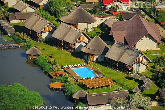 Aerial over Green Village lodge, Sfinthu Gheorghe, within the Danube delta rewilding area, Romania June 2012  ,  AERIAL VIEW,AERIALS,DANUBE,DELTA,EASTERN EUROPE,ECO TOURISM,EUROPE,HABITAT,HOMES,HOTEL,LANDSCAPES,LODGES,REWILDING,STAFFAN WIDSTRAND,SWIMMING POOL,TOURISM,VILLAGES,WATER,WETLANDS,WWE  ,  Wild Wonders of Europe / Widstrand