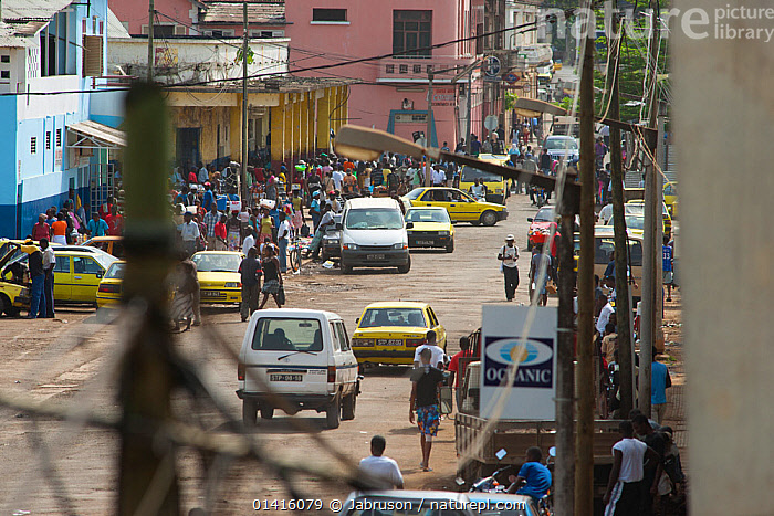 Sao Tome street scene, development of third world infrastructure with vehicles, buildings and electricity cables. Democratic Republic of Sao Tome and Principe off Gulf of Guinea 2009  ,  AFRICA,BRUCE DAVIDSON,CARS,CENTRAL AFRICA,CITIES,ENVIRONMENTAL,LANDSCAPES,MARKETS,PEOPLE,POOR,ROADS,STREETS,URBAN,VEHICLES  ,  Jabruson