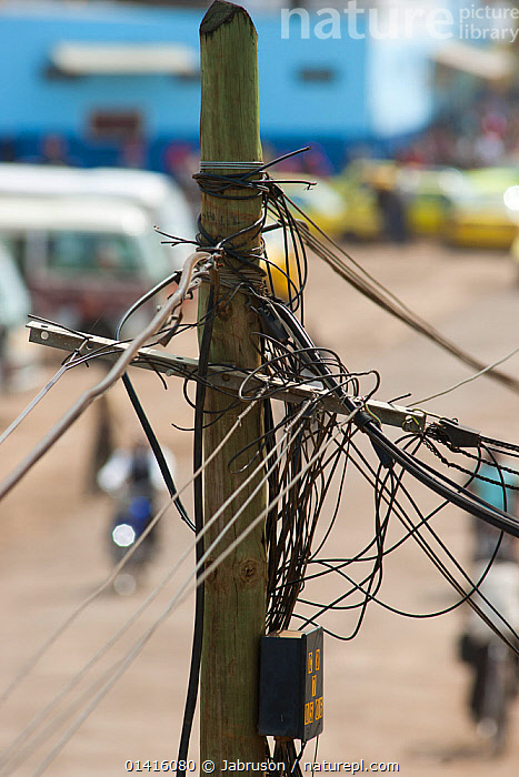Telephone cables and junction box on post, signs of development of third world infrastructure, Sao Tome, Democratic Republic of Sao Tome and Principe, off Gulf of Guinea, Central Africa 2009  ,  AFRICA,BRUCE DAVIDSON,CABLES,CENTRAL AFRICA,CITIES,MESSY,POSTS,POWER,STREETS,URBAN,VERTICAL  ,  Jabruson