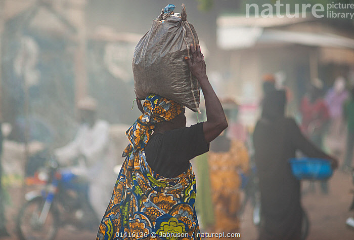 Street market with woman carrying bag of charcoal on her head. Maroua, Northern Cameroon, September 2009  ,  AFRICA,CARRYING,FUEL,TOWNS,VILLAGES,WEST AFRICA,WOMAN,WOMEN , Bruce Davidson  ,  Jabruson