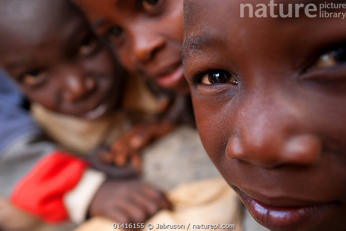 Mozambican children close up interested in camera. Pemba to Montepuez highway, north-eastern Mozambique, November 2011.  ,  AFRICA,CHILDREN,GROUPS,MOZAMBIQUE,OUTDOORS,PEOPLE,PORTRAITS,SOUTHERN AFRICA , Bruce Davidson  ,  Jabruson