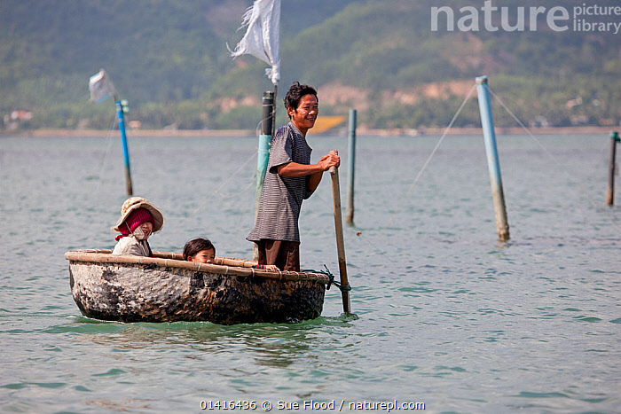 Family in round coracle style fishing boat in Baie du Cumon, Vietnam November 2011  ,  ASIA,BOATS,CHILDREN,COASTS,CORACLES,CULTURES,FAMILIES,FISHING BOATS,GROUPS,LANDSCAPES,PEOPLE,ROUND,SEA,SOUTH EAST ASIA,TRADITIONAL,TRANSPORT,TRAVEL,OPEN-BOATS  ,  Sue Flood