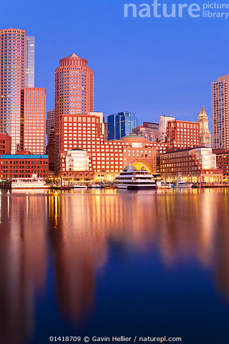Skyline and inner harbour including Rowes Wharf at dawn, Boston, Massachusetts, USA 2009. No release available., BOATS,BOSTON,BUILDINGS,CITIES,CITYSCAPES,COASTAL WATERS,COASTS,CRUISING,DAWN,HARBOURS,LANDSCAPES,MOORED,MOTORBOATS,NORTH AMERICA,REFLECTIONS,TRAVEL,URBAN,USA,VERTICAL,WATER,YACHTS,Catalogue5, Gavin Hellier