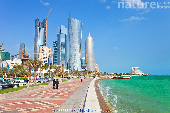 View along the Corniche towards the new skyline of the West Bay central financial district of Doha, Qatar, Arabian Peninsula, 2011. No release available., ARABIA,Arabian Peninsula,Arabian Peninsula,ASIA,background people,building exterior,BUILDINGS,catalogue5,CITIES,coastal,COASTAL WATERS,COASTS,Corniche,Doha,financial district ,high rise building,MEN,mid adult,MIDDLE EAST,MODERN,outdoors,PEOPLE,qatar,sea,skyline,skyscrapers,Travel,URBAN,WALKING,WATER,West Bay, Gavin Hellier