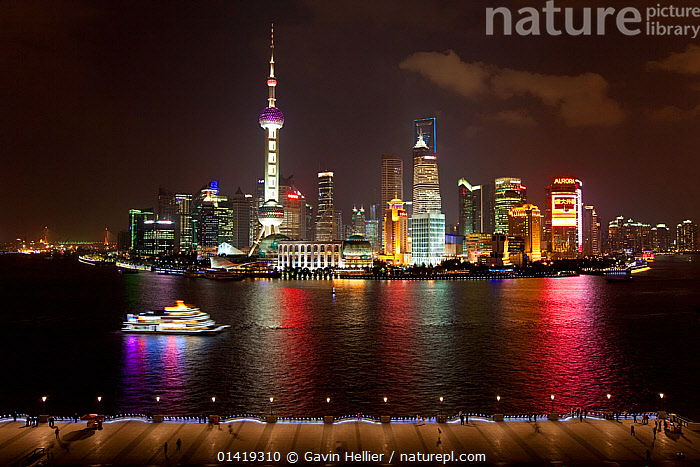 New Pudong skyline, looking across the Huangpu River from the Bund, Shanghai, China 2010. No release available., architecture,ASIA,background people,boat,BOATS,BUILDINGS,Bund,catalogue5,CHINA,CITIES,city,electricity,elevated view,Huangpu River ,ILLUMINATED,LIGHTS,lit up,MODERN,NIGHT,on the move,outdoors,PEOPLE,Pudong ,REFLECTIONS,Republic of China,RIVERS,Shanghai,skyline,skyscrapers,transportation,Travel,travel destination,URBAN,using power,view to land,WATER,WORKING BOATS, Gavin Hellier