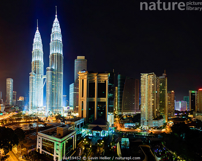 Elevated night view of the Petronas Twin Towers, illuminated at night, Kuala Lumpur, Malaysia, 2012. No release available.  ,  architecture,ASIA,building exterior,capital,catalogue5,CITIES,city,cityscape,electricity,elevated view,famous place,iconic,ILLUMINATED,ILLUMINATION,Kuala Lumpur,landmark,LIGHTS,lit up,Malaysia,MODERN,NIGHT,Nobody,outdoors,Petronas Twin Towers,skyline,skyscrapers,SOUTH EAST ASIA,towers,Travel,travel destination,tropics,URBAN,using power  ,  Gavin Hellier