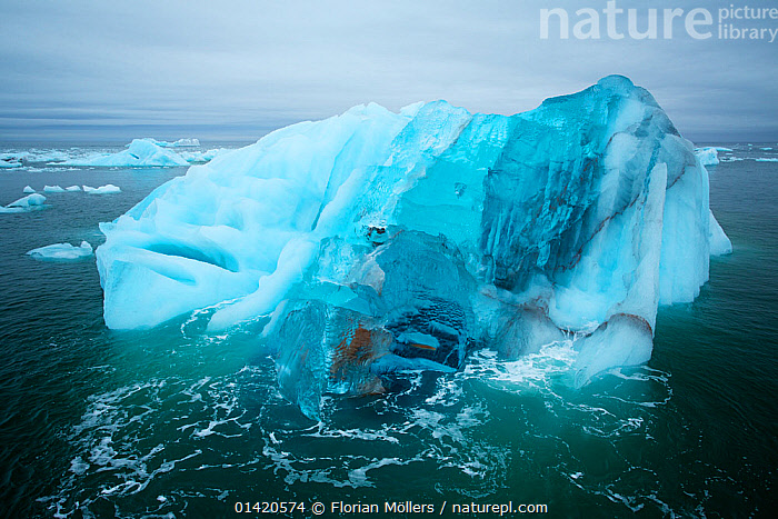 Blue iceberg drifting off Brasvellbreen glacier, Austfonna, Nordaustlandet, Svalbard, Norway, July 2012  ,  archipelago,ARCTIC,Austfonna,BLUE,Brasvellbreen glacier,catalogue5,drifting,elevated view,EUROPE,floes,GLACIAL FEATURES,GLACIERS,ICE,iceberg,ICEBERGS,icefloes,LANDSCAPES,MARINE,nature,Nobody,Nordaustlandet,NORWAY,outdoors,Physical Geography,POLAR,SCANDINAVIA,sea,spitsbergen,spitzbergen,SURFACE,Svalbard,Geology  ,  Florian Möllers