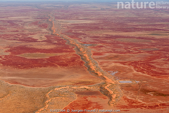 Aerial of Sturt Stoney Desert with gibber rocks. Gibber rocks are millions of years wind and water weathered chalcedonised sandstone with a hardened crust of soil cemented silica, iron and manganese, Australia. June 2011  ,  catalogue6,AUSTRALIA,Origins,Evolutionary,Ancient,Natural Condition,Weathered,Distressed,Weathering,Colour,Red,No One,Nobody,Australasia,Australia,Full Frame,Aerial View,Birds Eye View,High Angle View,Desert,Deserts,Rock,Sandstone,Landscape,Landscapes,Outdoors,Open Air,Outside,Day,Elevated view,Expansive,Vast,Sturt stony Desert,Gibber Rocks,,Immense,Vast,Space,Open Spaces,  ,  Jurgen Freund