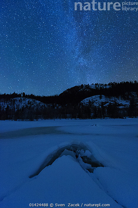 Frozen lake at night in under the Milky Way. Flatanger, Norway, January 2010.  ,  catalogue6,NORWAY,Magic,Magical,Frozen,No One,Nobody,Temperature,Cold,Chill,Chilly,Months,January,Europe,Northern Europe,North Europe,Nordic Countries,Scandinavia,Norway,Stars,Countryside,Outdoors,Open Air,Outside,Winter,Night,Nature,Natural,Natural World,Beauty In Nature,Woodland,Freshwater,Lake,Forest,Starry,Milky Way,Flatanger  ,  Sven  Zacek