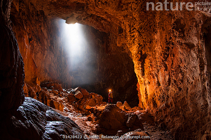 Potholer exploring the Graller del Boixaguer cave, Montsec mountains, Pyrenees, Catalonia, Spain, May 2012. Model released.  ,  catalogue6,SPAIN,People,Male,Man,Scale,Proportion,Inside,1 Person,Single,Single Person,Europe,Southern Europe,South Europe,Iberian Peninsula,Spain,Catalonia,Lighting,Electric Light,Flashlight,Flashlights,Torch,Torches,Cave,Rock,Exploration,Pyrenees,Potholing,Natural Light,Graller del Boixaguer,Montsec Mountains  ,  Inaki  Relanzon