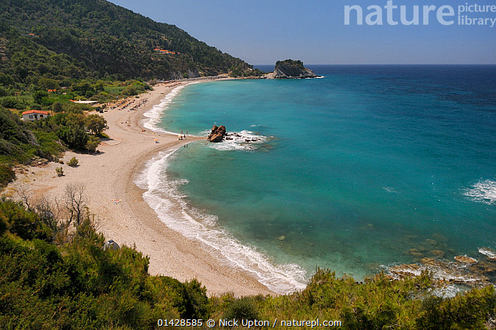 Overview of Potami beach near Karlovasi on the northeast coast of Samos. Eastern Sporades, Greece, July 2012.  ,  BEACHES,BUILDINGS,COASTS,EUROPE,GREECE,LANDSCAPES,MEDITERRANEAN,OUTDOORS,PEOPLE,SEASCAPES  ,  Nick Upton