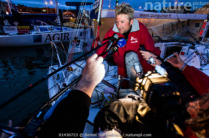 Skipper Yann Elies after winning la Solitaire du Figaro on board 'Groupe Queguiner-Leucemie Espoir'. Dieppe, France, June 22nd 2013. All non-editorial uses must be cleared individually.  ,  ARRIVALS,BOATS,COASTS,CREWS,DUSK,EUROPE,FILMING,FRANCE,HARBOURS,INTERVIEW,INTERVIEWS,LIGHTS,MAN,MEDIA,NIGHT,PEOPLE,PHOTOGRAPHY,RACES,SAILING BOATS,SKIPPER,SOLO,SPECTATORS,TOWNS,YACHTS  ,  Benoit Stichelbaut