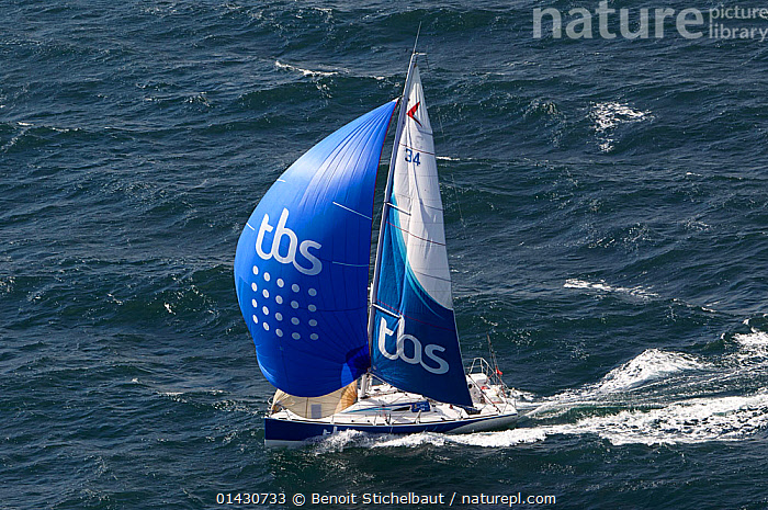 Figaro 'TBS' skippered by Michel Desjoyeaux under spinnaker during training for la Solitaire du Figaro, Port la Foret, France, April 2013. All non-editorial uses must be cleared individually., AERIALS,BOATS,CHOPPY,EUROPE,FRANCE,MAINSAILS,PROFILE,RACES,SAILING BOATS,SAILS,SOLO,SPINNAKERS,YACHTS, Benoit Stichelbaut