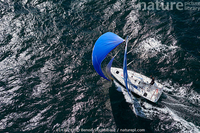 Aerial view of Figaro 'TBS' skippered by Michel Desjoyeaux in training for la Solitaire du Figaro, Port la Foret, France, April 2013. All non-editorial uses must be cleared individually., ADVENTURE,AERIALS,ATMOSPHERIC,BOATS,CREWS,DECKS ,EUROPE,FORESAILS,FRANCE,MAINSAILS,MAN,PEOPLE,RACES,RIPPLES,SAILING BOATS,SAILS,SKIPPER,SOLO,SPINNAKERS,WAKE,WIND,YACHTS,BOAT-PARTS,Weather, Benoit Stichelbaut