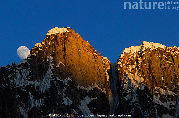 Moon rising from behind mountains, seen from Gore II camp (4,400m), Baltoro Glacier, Central Karakoram National Park, Pakistan, June 2007.  ,  ASIA,HIMALAYA,HIMALAYAS,INDIAN SUBCONTINENT,KARAKORAM,LANDSCAPES,MOON,MOUNTAINS,NP,RESERVE,SNOW,UPLANDS,National Park  ,  Enrique Lopez-Tapia