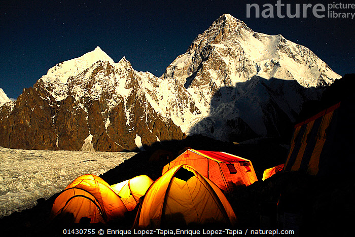 Broad Peak base camp (4,960 m) at night, with K2 (8,611m) and the Godwin-Austen glacier in the background lit by moonlight, Central Karakoram National Park, Pakistan, June 2007. Winner of Photographer of the Year, Landscapes and Seascapes Category, Pollux Awards 2012  ,  ASIA,CAMPING,GLACIERS,INDIAN SUBCONTINENT,K2,karakoram,LANDSCAPES,MOUNTAINEERING,MOUNTAINS,NIGHT,NP,RESERVE,SNOW,tent,tents,UPLANDS,catalogue6,PAKISTAN,Adventure,Adventures,Adventurous,Colour,Yellow,Group,Medium Group,No One,Nobody,Luminosity,Glow,Glows,Snowcapped,Asia,Indian Subcontinent,Pakistan,Tent,Mountain,Light,Lights,Shadow,Ice,Glacier,Glacial,Glaciers,Moonlight,Moonlit,Landscape,Landscapes,Outdoors,Open Air,Outside,Night,Exploration,Montane,High altitude,Altitude,Medium Group of Objects,Lit Up,Karakoram National Park,Broad Peak,Base Camp,Godwin Austen glacier,Geology,SPORTS,National Park  ,  Enrique Lopez-Tapia,Enrique Lopez-Tapia
