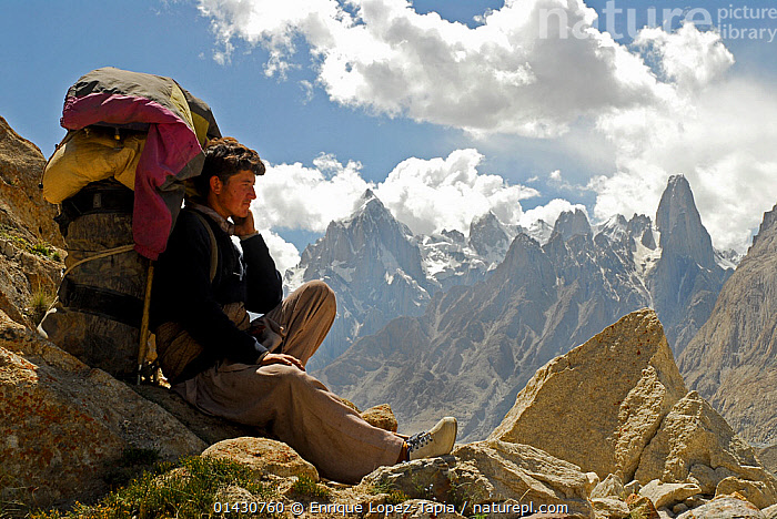 A Balti porter resting, with mountains in the background, Central Karakoram National Park, Pakistan, July 2007., ASIA,ASIAN ETHNICITY,CARRYING,GLACIERS,HIKING,HIMALAYA,HIMALAYAS,INDIAN SUBCONTINENT,KARAKORAM,LANDSCAPES,MAN,MOUNTAINS,OUTDOORS,PEOPLE,PORTER,PORTRAITS,TREKKING,UPLANDS,WALKING,Geology, Enrique Lopez-Tapia
