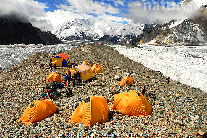Broad Peak base camp (4,960m) on the Godwin-Austen Glacier, Central Karakoram National Park, Pakistan, June 2007., ASIA,CAMPING,GLACIERS,HIMALAYA,HIMALAYAS,INDIAN SUBCONTINENT,KARAKORAM,LANDSCAPES,MOUNTAINEERING,MOUNTAINS,OUTDOORS,PEOPLE,TENT,TENTS,UPLANDS,Geology,SPORTS, Enrique Lopez-Tapia