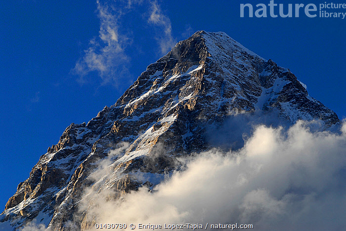 View looking up to the summit of K2 (8,611m), Central Karakoram National Park, Pakistan, June 2007  ,  ASIA,CLOUDS,HIMALAYA,HIMALAYAS,INDIAN SUBCONTINENT,KARAKORAM,LANDSCAPES,MOUNTAINS,NP,PEAK,PEAKS,RESERVE,SNOW,SUMMITS,UPLANDS,Weather,National Park  ,  Enrique Lopez-Tapia