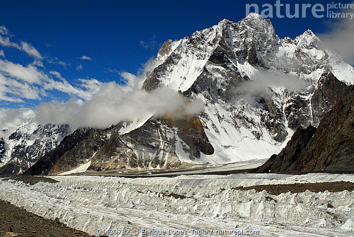 View of the Godwin-Austen Glacier, with Broad Peak (8,051m) in the background, Central Karakoram National Park, Pakistan, June 2007.  ,  ASIA,CLOUDS,GLACIERS,HIMALAYA,HIMALAYAS,ICE,INDIAN SUBCONTINENT,KARAKORAM,LANDSCAPES,MOUNTAINS,NP,RESERVE,SNOW,UPLANDS,Weather,Geology,National Park  ,  Enrique Lopez-Tapia