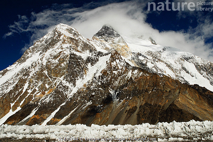 Broad Peak (8,047m), with the Godwin-Austen Glacier in the foreground, Central Karakoram National Park, Pakistan, June 2007., ASIA,ATMOSPHERIC,CLOUDS,GLACIERS,HIMALAYA,HIMALAYAS,ICE,INDIAN SUBCONTINENT,KARAKORAM,LANDSCAPES,MOUNTAINS,NP,RESERVE,SNOW,UPLANDS,Weather,Geology,National Park, Enrique Lopez-Tapia