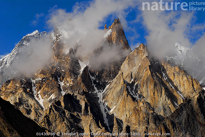 View of Trango Towers (6,286m), Central Karakoram National Park, Pakistan, July 2007.  ,  ASIA,CLOUDS,INDIAN SUBCONTINENT,karakoram,LANDSCAPES,MOUNTAINS,NP,peak,peaks,RESERVE,SNOW,summit,summits,UPLANDS,catalogue6,PAKISTAN,No One,Nobody,Jagged,Craggy,Rugged,Furious,Asia,Indian Subcontinent,Pakistan,Close Up,Mountain,Summit,Cloud,Mist,Outdoors,Open Air,Outside,Day,Montane,High altitude,extreme terrain,Altitude,Trango Towers,Karakoram National Park,Weather,National Park  ,  Enrique Lopez-Tapia,Enrique Lopez-Tapia