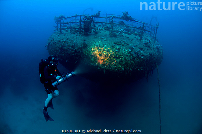 Wreck of the cargo ship 'Iouna'. Diver and ships stern with navigation light still attached on rail. Wrecked between 1912-1918. Sharmo reef, Yanbu, Saudi Arabia, July 2010, ASIA,BOAT PARTS,BOATS,DIVING,MARINE,PEOPLE,TROPICAL,UNDERWATER,WATER PURSUITS,WORKING BOATS,WRECKS,ARABIA, Michael Pitts