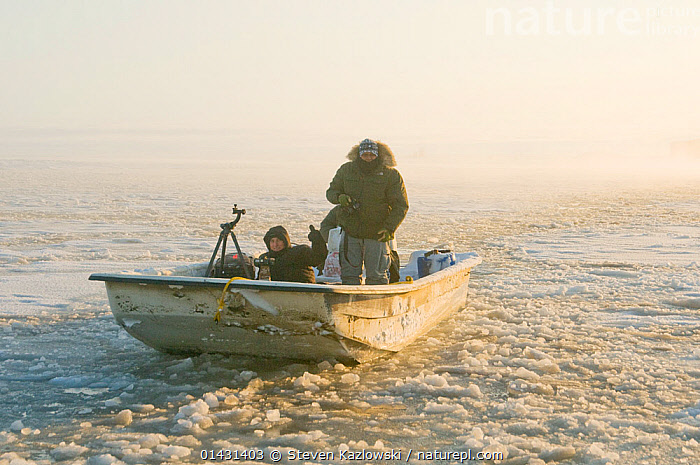 Photographers in a skiff along the coast during autumn freeze up, Beaufort Sea, off the 1002 area of the Arctic National Wildlife Refuge, North Slope, Alaska  ,  ARCTIC,ARCTIC OCEAN,BOATS,COASTAL WATERS,COLD,FRONT VIEWS,ICE,NORTH AMERICA,OPEN BOATS,PEOPLE,PHOTOGRAPHERS,PHOTOGRAPHY,SKIFFS,SLUSH,THUMBS UP ,USA  ,  Steven Kazlowski