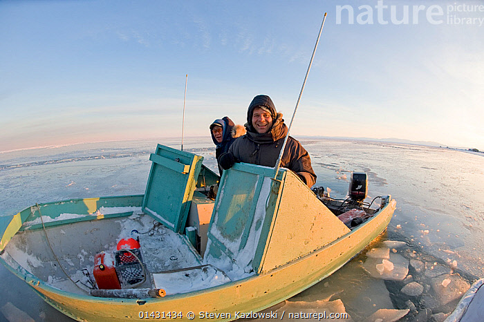 Photographer Steven Kazlowski and his friend in a skiff along the coast during autumn freeze up, Beaufort Sea, off the 1002 area of the Arctic National Wildlife Refuge, North Slope, Alaska, NORTH AMERICA,PEOPLE,SMILING,BOATS,HAPPY,MOTOR BOATS,OPEN BOATS,PHOTOGRAPHERS,PHOTOGRAPHY,SKIFFS,WORKING BOATS,USA, Steven Kazlowski