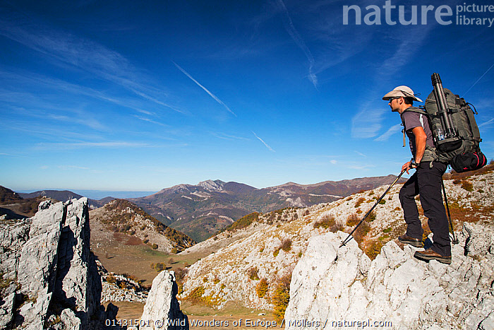 Hiker on limestone ridge in Mehedinti Plateau Geopark, Romania, October 2012, EUROPE,FLORIAN MOELLERS,MAN,OUTDOOR PURSUITS,REWILDING,ROMANIA,SKIES,WWE,EASTERN EUROPE,HIKING,HORIZONTAL,LEISURE,MOUNTAINS,PEOPLE,PROFILE,WALKING, Wild Wonders of Europe / Möllers