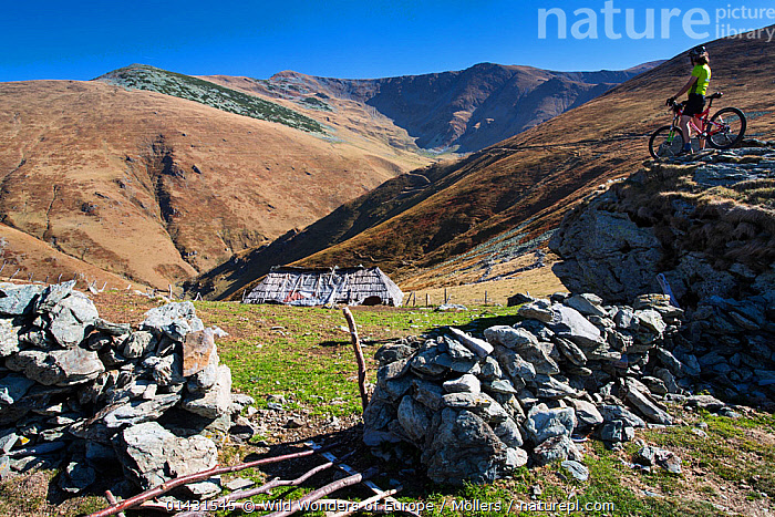 Cyclist on rock, next to stone wall, Southern Carpathians, Muntii Tarcu, Caras-Severin, Romania, October 2012, EUROPE,FLORIAN MOELLERS,OUTDOOR PURSUITS,REWILDING,ROMANIA,WWE,CYCLISTS,EASTERN EUROPE,HORIZONTAL,LANDSCAPES,MOUNTAINS,PEOPLE, Wild Wonders of Europe / Möllers