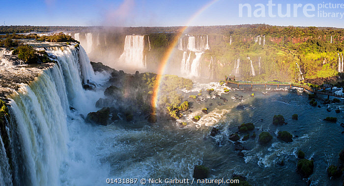 Rainbow over Iguasu Falls, on the Iguasu River, Brazil / Argentina border. Photographed from the Brazilian side of the Falls. State of Parana, Brazil. September 2012  ,  FRESHWATER,LANDSCAPES,RAINBOWS,RIVERS,SOUTH AMERICA,UNESCO,BORDERS,BRAZIL,IGUAZU,WATER,WATERFALLS,WORLD HERITAGE SITES,Weather  ,  Nick Garbutt
