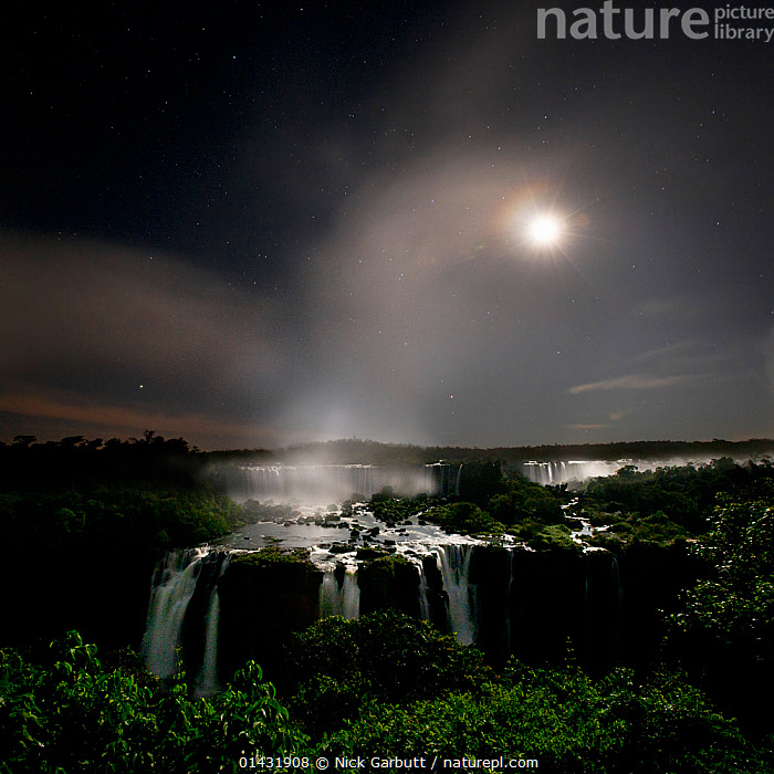 Iguasu Falls by moonlight, on the Iguasu River, Brazil / Argentina border. Photographed from the Brazilian side of the Falls. State of Parana, Brazil., catalogue6,BRAZIL,Atmospheric Mood,Atmospheric,No One,Nobody,Atmosphere,Latin America,South America,Argentina,Brazil,Geographical Border,Light,Lights,Sunlight,Outdoors,Open Air,Outside,Day,Reserve,The Sun,Protected area,National Park,South American National Parks,Iguacu National Park,Parana,Iguazu Waterfall, Nick Garbutt