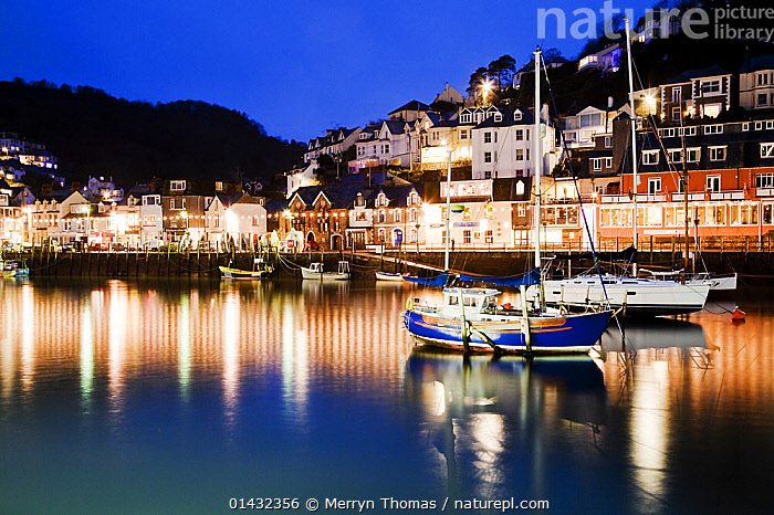 View of Looe harbour at night, Looe, Cornwall, England, January 2013.  ,  BOATS,EUROPE,HARBOURS,MOORED,REFLECTIONS,WORKING BOATS,BUILDINGS,ENGLAND,FISHING BOATS,LIGHTS,NIGHT,PROFILE,TOWNS,UK,WINTER,United Kingdom  ,  Merryn Thomas