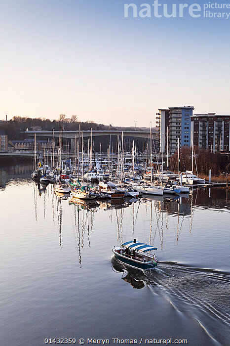 View over Penarth Marina, Cardiff, Wales, February 2012.  ,  BUILDINGS,CALM,CITIES,DUSK,LANDSCAPES,UK,URBAN,WAKE,BOATS,DAWN,EUROPE,FERRIES,HARBOURS,MARINAS,MIXED BOATS,MOORED,REFLECTIONS,VERTICAL,WAKES,WALES,WORKING BOATS,WORKING-BOATS ,United Kingdom  ,  Merryn Thomas