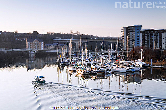 View over Penarth Marina, Cardiff, Wales, February 2012.  ,  BUILDINGS,CALM,CITIES,DUSK,LANDSCAPES,UK,URBAN,WAKE,BOATS,DAWN,EUROPE,FERRIES,HARBOURS,MARINAS,MIXED BOATS,MOORED,REFLECTIONS,WAKES,WALES,WORKING BOATS,WORKING-BOATS ,United Kingdom  ,  Merryn Thomas