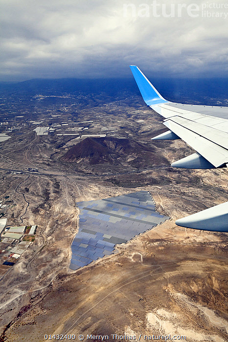 Photovoltaic power station seen from an aeroplane, Tenerife, Canary Islands, Spain, April 2012.  ,  CANARY ISLANDS,ENERGY,HIGH ANGLE SHOT,AIRCRAFT,ATLANTIC ISLANDS,ENVIRONMENTAL,FLYING,VERTICAL,WINGS,SPAIN,Europe  ,  Merryn Thomas