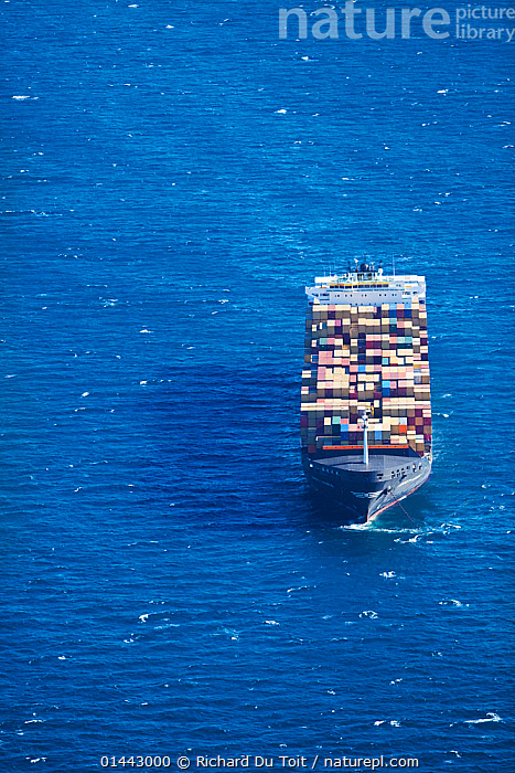 Aerial photograph of container ship near Cape Town Harbour, Atlantic Ocean, South Africa, Western Cape Province, March 2010  ,  catalogue6,On The Move,No One,Nobody,Weight,Africa,Southern Africa,South Africa,Copy Space,Vertical,Aerial View,Birds Eye View,High Angle View,Man Made,Land Vehicle,Boat,Boats,Industrial Ship,Cargo Ship,Cargo Boats,Cargo Ships,Freighter,Container Ship,Container Ships,Freighters,Ocean,Atlantic Ocean,Landscape,Landscapes,Outdoors,Open Air,Outside,Day,Transportation,Freight Transportation,Consignment,Consignments,Freight,Ship,Shipping,Shipping Industry,Marine,Coastal waters,Working boats,Cargo boat,Saltwater,Cape floristic region,Biodiversity hotspots,Biodiversity hotspot,Elevated view,South African,Moving,One Object  ,  Richard Du Toit