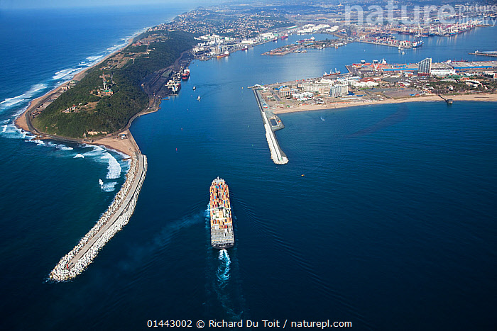 Aerial photograph of Durban Harbour breakwater with freighter boat entering the harbour, KwaZulu-Natal Province,South Africa, May 2010  ,  AFRICA,SOUTHERN AFRICA,SOUTH AFRICA,HORIZONTAL,AERIAL VIEW,AERIAL,AERIAL PHOTO,AERIAL PHOTOGRAPHS,AERIAL PHOTOGRAPHY,AERIAL PHOTOS,AERIAL SHOT,AERIAL SHOTS,AERIAL VIEWS,AERIALS,BIRDS EYE PERSPECTIVE,BIRDS EYE PERSPECTIVES,BIRDS EYE VIEW,BIRDS EYE VIEWS,BIRDS EYE PERSPECTIVE,BIRDS EYE PERSPECTIVES,BIRDS EYE VIEW,BIRDS EYE VIEWS,OVERHEAD,MAN MADE,SETTLEMENT,PLACE,PLACES,SETTLEMENTS,HARBOUR,HARBOR,HARBORS,HARBOURS,PORTS,SEAPORT,SEAPORTS,CITY,CITIES,TOWNS,MAN MADE STRUCTURE,BUILT STRUCTURE,STRUCTURE,STRUCTURES,INFRASTRUCTURE,INFRASTRUCTURES,WATER MANAGEMENT INFRASTRUCTURE,WATER MANAGEMENT INFRASTRUCTURES,BREAKWATER,BREAKWATERS,GROYNES,BOAT,BOATS,INDUSTRIAL SHIP,CARGO SHIP,CARGO BOATS,CARGO SHIPS,FREIGHTER,CONTAINER SHIP,CONTAINER SHIPS,FREIGHTERS,COASTLINE,COASTLINES,LANDSCAPE,LANDSCAPES,SCENIC,COAST,MARINE,COASTAL WATERS,COASTAL,WORKING BOATS,CARGO BOAT,SALTWATER,SALT WATER,SEA WATER,CAPE FLORISTIC REGION,BIODIVERSITY HOTSPOTS,BIODIVERSITY HOTSPOT,WORKING-BOATS  ,  Richard Du Toit