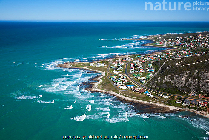 Aerial photograph of Western Cape Province, Cape Agulhas, Indian Ocean, South Africa, August 2010, catalogue6,Community,Communities,No One,Nobody,Curve,Africa,Southern Africa,South Africa,Horizontal,Aerial View,Birds Eye View,High Angle View,Man Made,Settlement,Town,Towns,Man Made Structure,Building,Building Exterior,Residential Structure,House,Houses,Horizon,Horizon Over Water,Coastlines,Ocean,Indian Ocean,Wave,Landscape,Landscapes,Outdoors,Open Air,Outside,Day,Coast,Marine,Coastal,Saltwater,Cape floristic region,Biodiversity hotspots,Biodiversity hotspot,View to sea,Elevated view,South African,Cape Agulhas, Richard Du Toit