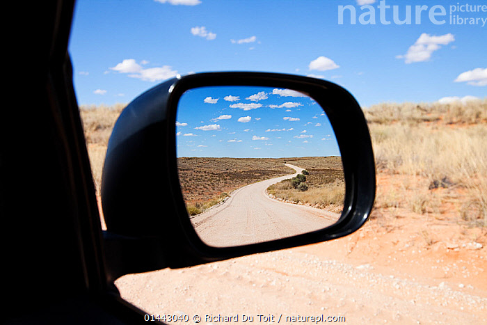 Wing mirror view of road through Kgalagadi Transfrontier Park, Northern Cape Province, Road, South Africa, February 2013 (This image may be licensed either as rights managed or royalty free.), AFRICA,SOUTHERN AFRICA,SOUTH AFRICA,HORIZONTAL,MAN MADE,THOROUGHFARE,ROUTE,ROUTES,ROAD,ROADS,ROADWAY,ROADWAYS,MODE OF TRANSPORT,VEHICLE,VEHICLES,PART OF VEHICLE,REARVIEW MIRROR,AUTO MIRROR,AUTO MIRRORS,AUTOMOBILE MIRROR,AUTOMOBILE MIRRORS,CAR MIRROR,CAR MIRRORS,REAR VIEW MIRROR,REAR VIEW MIRRORS,REARVIEW MIRRORS,SIDEVIEW MIRROR,SIDEVIEW MIRRORS,VEHICLE MIRROR,VEHICLE MIRRORS,WING MIRROR,WING MIRRORS,LANDSCAPE,LANDSCAPES,SCENIC,RF, royalty free, RF3,,RF3,,RF,, Richard Du Toit