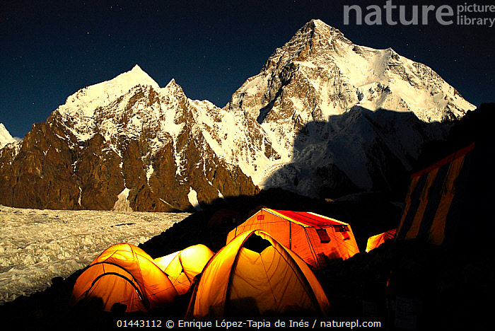 Broad Peak base camp at altitude of 4960 m, with the light of the full moon on Godwin Austen glacier and mountain K2. Central Karakorum National Park. Pakistan. June 2007 Winner of Photographer of the Year, Landscapes and Seascapes Category, 4th Pollux Awards, 2012, Asia,Baltoro,Glacier,Himalaya,Karakorum,Pakistan,Paquistán,glaciar,montaña,moonlight,mountain,catalogue6,Magic,Magical,Sayings,Getting Away From It All,Away From It All,Colour,Yellow,Group,Medium Group,No One,Nobody,Luminosity,Glow,Glows,Snowcapped,Asia,Indian Subcontinent,Pakistan,Horizontal,Man Made,Man Made Structure,Tent,Mountain,Light,Lights,Ice,Glacier,Glacial,Glaciers,Snow,Moonlight,Moonlit,Landscape,Landscapes,Outdoors,Open Air,Outside,Night,Reserve,Protected area,National Park,Montane,High altitude,Altitude,Medium Group of Objects,Lit Up,Karakoram Range,Broad Peak,Base Camp,Godwin Austen glacier,Five Objects,K2,Central Karakorum National Park,Extreme Camping,Geology, Enrique López-Tapia de Inés