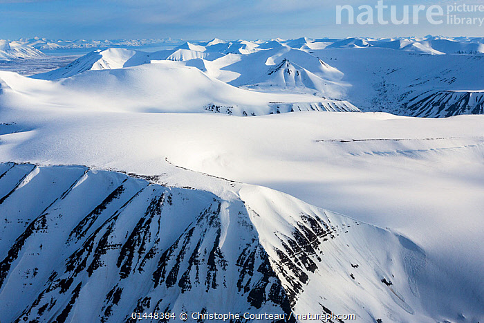Aerial View of Spitzbergen, Svalbard, Norway, June 2012.  ,  catalogue6,No One,Nobody,Europe,Northern Europe,North Europe,Nordic Countries,Scandinavia,Norway,Svalbard,Arctic,Polar,Arctic Circle,Aerial View,Birds Eye View,High Angle View,Mountain,Summit,Snow,Landscape,Landscapes,Outdoors,Open Air,Outside,Day,Exploration,Nature,Natural,Natural World,Elevated view,Spitzbergen,Virgin Snow  ,  Christophe Courteau