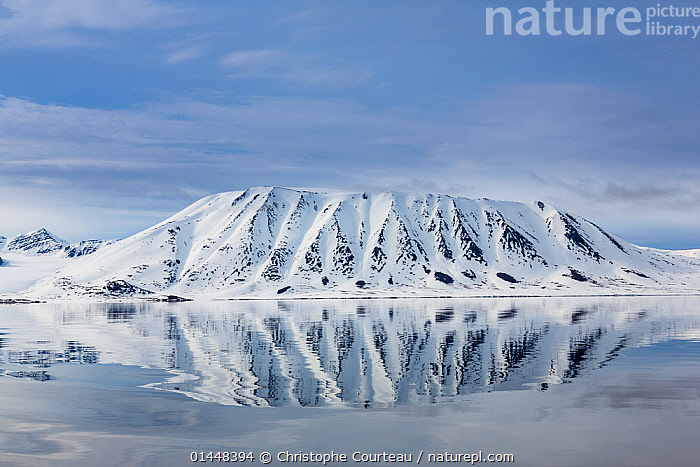 Landscape view across the Woodfjord, Spitzbergen, Svalbard, Norway, June, 2012.  ,  catalogue6,Mood,Calm,No One,Nobody,Temperature,Cold,Chill,Chilly,Europe,Northern Europe,North Europe,Nordic Countries,Scandinavia,Norway,Svalbard,Arctic,Polar,Arctic Circle,Coastlines,Mountain,Light,Lights,Light Effect,Reflection,Fjord,Fjords,Snow,Landscape,Landscapes,Outdoors,Open Air,Outside,Day,Nature,Natural,Natural World,Coast,Coastal,View to land,Spitzbergen,Woodfjord  ,  Christophe Courteau