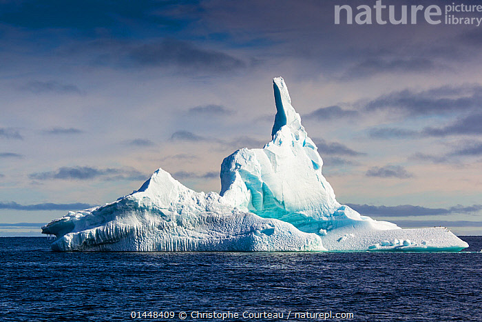 Iceberg, Spitzbergen, Norway, June, 2012.  ,  catalogue6,Eroding,Frozen,No One,Nobody,Europe,Northern Europe,North Europe,Nordic Countries,Scandinavia,Norway,Svalbard,Arctic,Polar,Arctic Circle,Sky,Cloud,Ice,Iceberg,Icebergs,Landscape,Landscapes,Outdoors,Open Air,Outside,Day,Coast,Marine,Coastal,Abstract,Abstracts,Saltwater,Sea,Dramatic,Sea ice  ,  Christophe Courteau