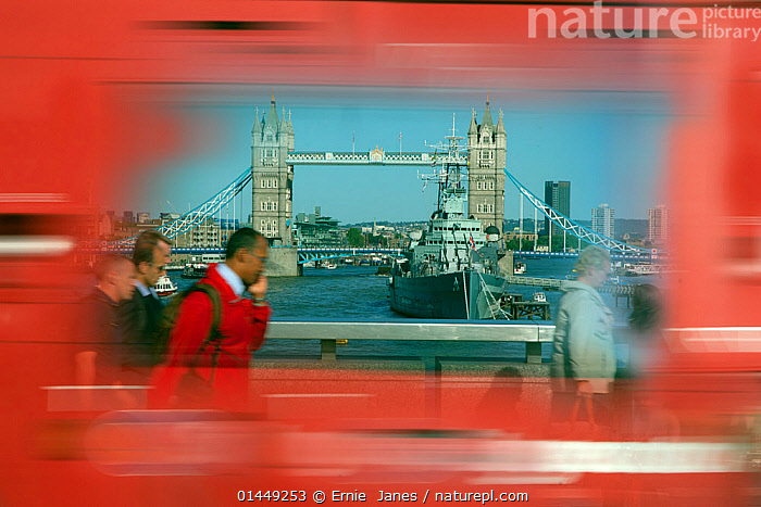 Abstract photo of Tower Bridge, with blurred motion red bus, London, June 2013. Digitally manipulated.  ,  catalogue6,Walking,People,Female,Woman,Male,Man,People Traveling,People Travelling,Traveler,Travelers,Traveling,Traveller,Travellers,Travelling,Pedestrian,Pedestrians,Incidental People,Incidental Person,People In The Background,Background People,Background Person,People In Background,Person In Background,Colour,Red,Famous Place,Landmark,Group,Group Of People,Small Group Of People,Few,5 People,Europe,Western Europe,UK,Great Britain,England,London,Greater London,Side View,Photographic Effect,Blurred Motion,Blurred Movement,Object,City,Building,Bridge,Bridges,Window,Window Pane,Window Panes,Windows,Mode Of Transport,Land Vehicle,Motor Vehicle,Bus,Buses,Boat,Boats,Battleship,Battleships,Military Ship,Military Ships,Navy Ship,Navy Ships,Warships,Outdoors,Open Air,Outside,Day,Abstract,Abstracts,Working boats,Naval,View Through,River Thames,United Kingdom  ,  Ernie  Janes